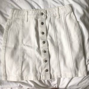 white pencil skirt with silver buttons